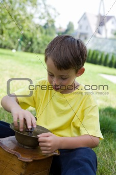 Boy and coffee mill