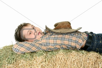 Country boy resting on hay
