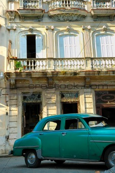 Green vintage car parked in Havana street
