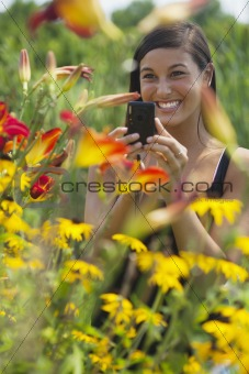 Beautiful Young Woman Photographing Flowers
