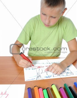 Schoolboy doing bored his homework on white