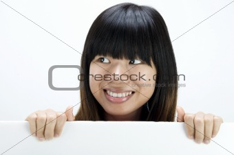 asian girl smiling with a blank card board