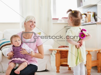 Delighted mother get surprise by her daughters