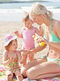 Happy young family at the beach