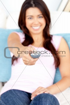 Captivating asian woman holding a remote smiling