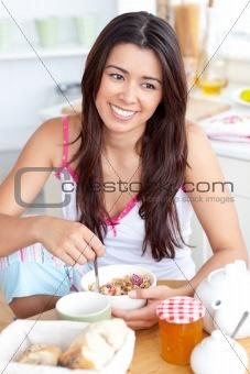 Beautiful asian woman having breakfast smiling at the camera sit