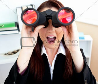 astonished young business woman using binoculars