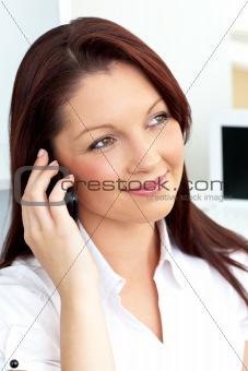 Positive businesswoman talking on phone sitting