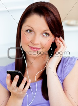Attractive woman using her cellphone to listen to music with ear