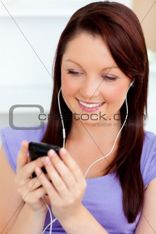 Charming woman listen to music using her cellphone