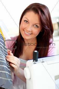 Attractive woman sewing at home