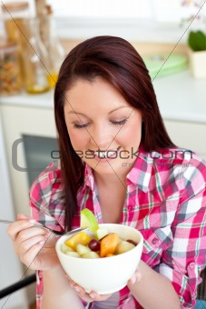 Glowing woman eating a healthy salad