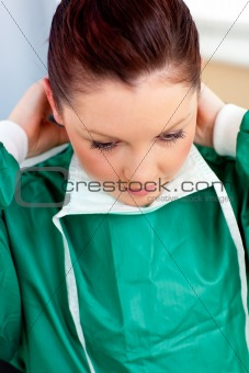 Assertive female surgeon wearing scrubs