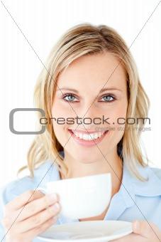 Charming businesswoman enjoying her coffee
