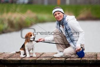 Girl walking with a dog
