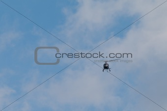 Small helicopter in sky