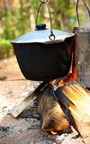 Kettles over campfire