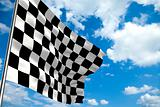 Waving checkered flag in front of a cloudy sky