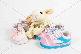 Little baby shoes and sheep over white background