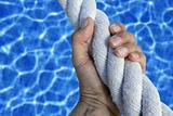 man hand grab grip sport blue pool big rope