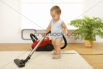 Baby boy with vacuum cleaner