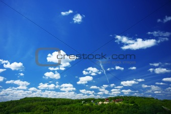 Blue sky and green forest