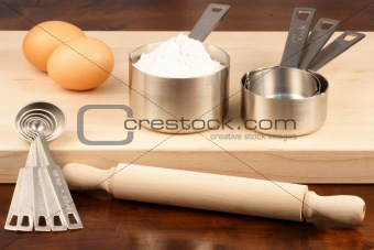 kitchen utensils over wood