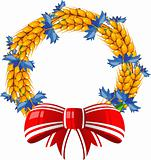 Wreath of ears and cornflower with a red bow