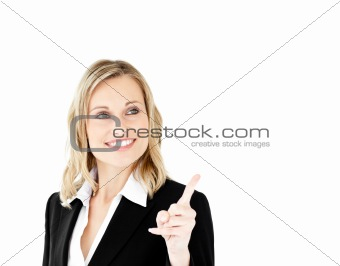 Bright young businesswoman showing a direction with a finger