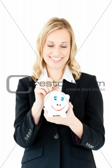 Caucasian woman putting money in a piggybank