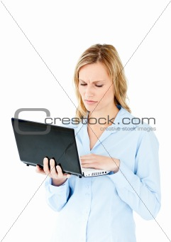 Young businesswoman getting frustrated with a laptop