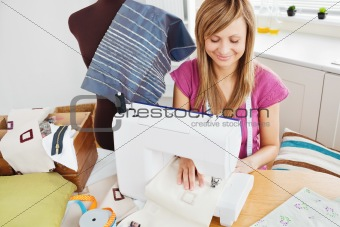 Bright woman sewing at home