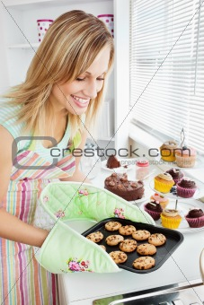 Charming woman baking in the kitchen
