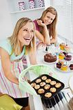 Laughing woman baking together