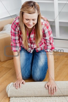 Positive woman roll a carpet out