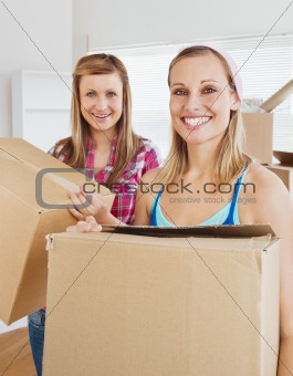 Charming friends holding boxes