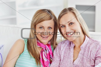 Portrait of two beautiful woman at home