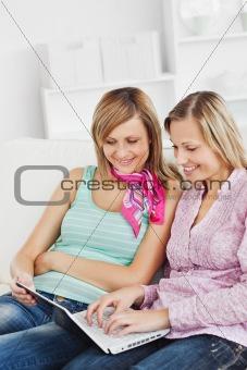 Positive friends using a laptop