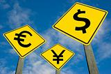 Euro, yen and dollar symbols on road sign.