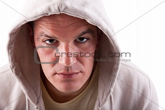 man looking to camera with a hood