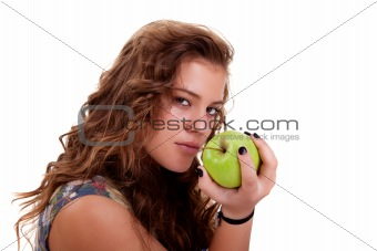 Beautiful girl eating a green apple
