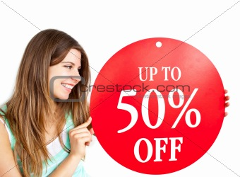 """Bright caucasian woman holding a """"up to 50% off"""" red banner"""
