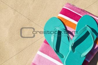 Flip-flops on towel.