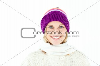 Beautiful young woman with cap in the winter smiling at the came