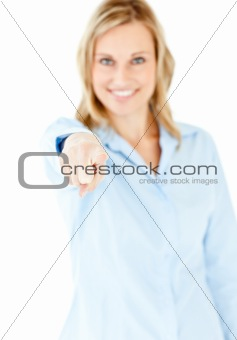 Bright young businesswoman showing with a finger at the camera