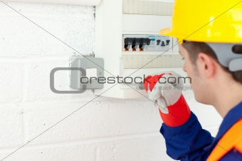 Mature electrician repairing a power plan