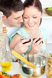 lovely young couple cooking together in the kitchen
