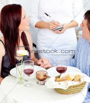 Attractive couple having dinner at the restaurant