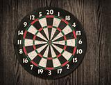 Dartboard on old wooden wall.