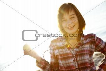 Portrait of beautiful brunet girl with headphones